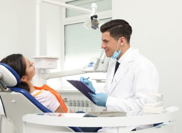 Professional dentist working with patient in clinic